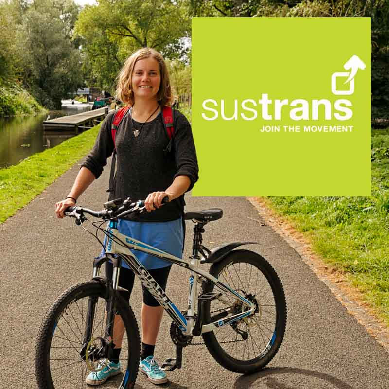 Commuter cyclist at Harrison Park, Edinburgh. Claire Frost by Iain Robinson for Sustrans Scottish Workplace Network 2016. Female cyclist commuting by mountain bike in Autumn, Scotland.