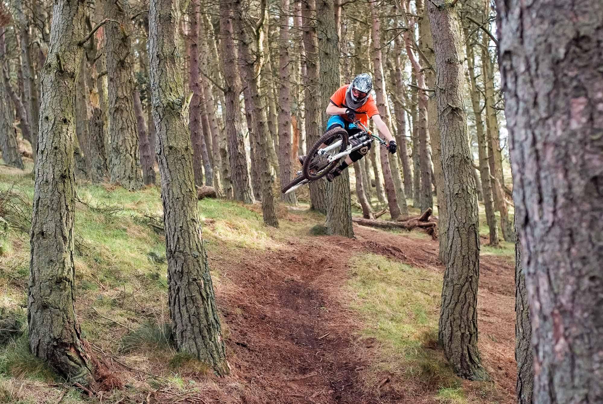 Mountain biker Keith Scott jumping his prototype Banshee Legend at Bonaly Trails, Edinburgh.